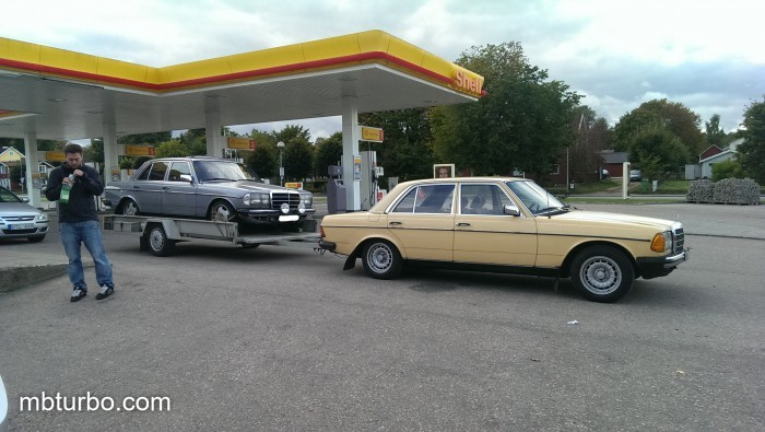 w123 on and pulling trailer
