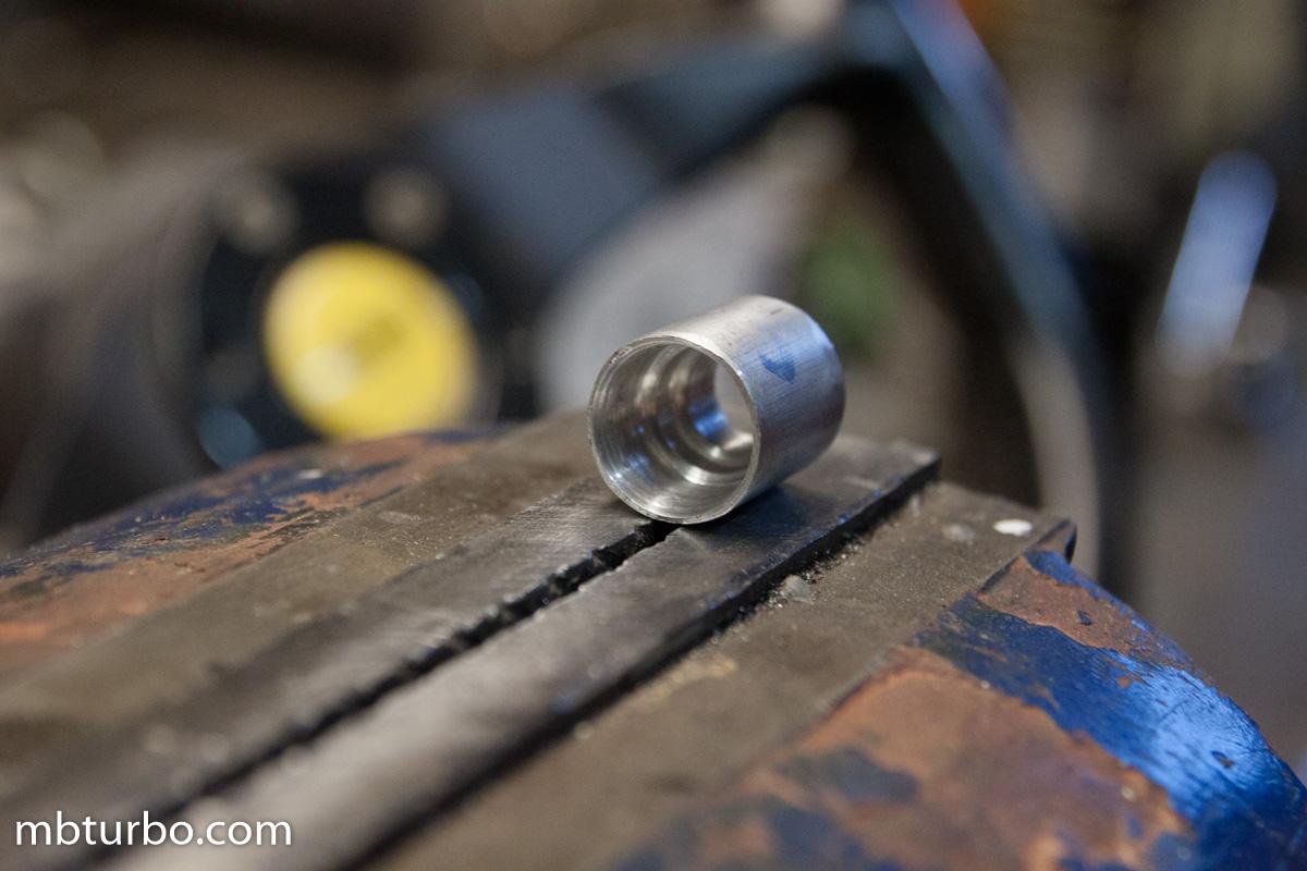 M103 intake manifold injector seat